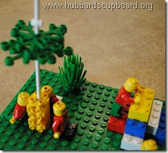 lego praying in the garden